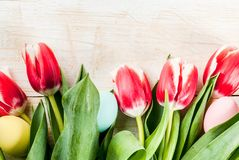 Background with easter eggs and tulips stock photo