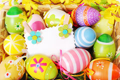 Background with easter painted eggs and greeting card Royalty Free Stock Photos