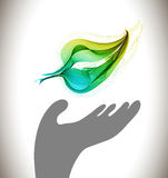 Background with ecological environment icon. Gray hand and green abstract leaf Stock Photos
