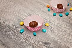 Background of eggs. Happy Easter lettering background with realistic golden shine decorated eggs, confetti, golden brush splash. V royalty free stock photos