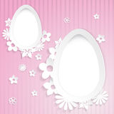 Background with eggs and paper flowers on pink Stock Photo