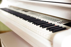 Background of electronic grand piano keyboard, close up Stock Images