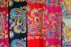 Silk clothes. The background of embroidered silk clothes stock image
