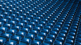 Background of empty blue stadium seats Royalty Free Stock Images