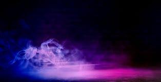 Background of an empty dark-black room. Empty brick walls, lights, smoke, glow, rays. Dark street with smoke, smog, street light, abstract light, night city royalty free stock image
