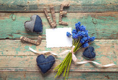 Background with an empty paper card, a bouquet of blue  muscari Stock Photo
