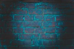 The background of an empty room with brick walls and concrete floor tiles. Neon light, spotlight royalty free stock photography