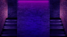 Background of an empty staircase, a brick wall, neon light, rays, smoke. royalty free stock photography