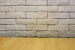 Background of empty white brick old wall, wooden floor stock photo