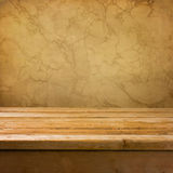 Background with empty wooden deck table. Over brown wall royalty free stock photography