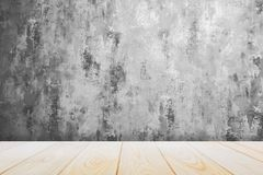 Background with empty wooden deck table over grunge cement wall, vintage, background, template royalty free stock photo