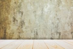 Background with empty wooden deck table over grunge cement wall, vintage, background, template royalty free stock image