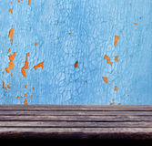 Background with empty wooden table and grunge wall Stock Photography