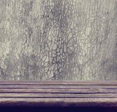 Background with empty wooden table and  grunge wall Stock Images