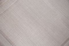 The background is an empty woven of diagonal threads. Serving na Royalty Free Stock Photos