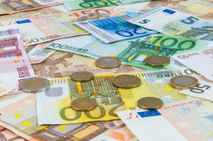 Background of euro banknotes and coins Stock Photo