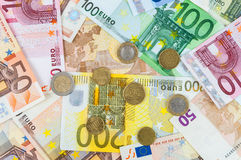 Background of euro banknotes and coins Stock Image