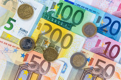 Background of euro banknotes and coins Stock Photography