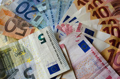 Background of euro bills. Time in money Royalty Free Stock Photography