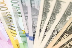 Background of euro and dollar bills. Shallow focus. Royalty Free Stock Image