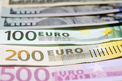 Background of euro and dollar bills. Shallow focus. Royalty Free Stock Photos