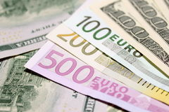 Background of euro and dollar bills. Shallow focus. Stock Images