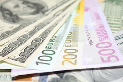 Background of euro and dollar bills. Shallow focus. Royalty Free Stock Photography