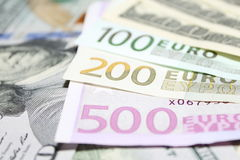 Background of euro and dollar bills. Shallow focus. Stock Photography