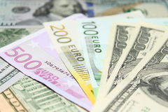 Background of euro and dollar bills. Shallow focus. Royalty Free Stock Photo