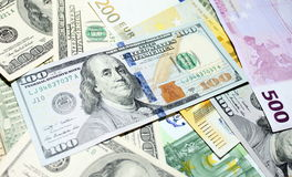 Background of euro and dollar bills. Shallow focus. Background of euro and dollar bills. USD EUR banknotes. Shallow focus stock images