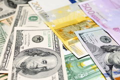 Background of euro and dollar bills. Shallow focus. Royalty Free Stock Images