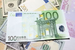 Background of euro and dollar bills. Shallow focus. Stock Photos