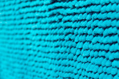 The background of the fabric. Bright blue background with blur, the basis is the deep-piled carpet close-up Stock Image
