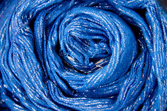 The background of the fabric. Bright blue background of the neckerchief, which was formed as a circle Stock Image