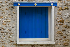 Background facade with wood window painted in blue Stock Photography