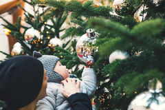 Background with family among Christmas decorations. Royalty Free Stock Photography