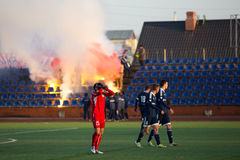 Background of fans on tribune with fires Stock Photography