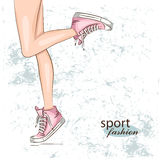 Background with fashionable sneakers. Stock Photos