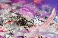 Background with feather and christmas silver chain. Background with feather and silver chain with snowflakes, pink,violet,purple Stock Images