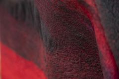 The background of the felt drape is black red. royalty free stock image