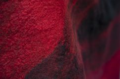 The background of the felt drape is black red. stock images
