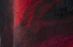 The background of the felt drape is black red. stock image