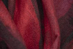 The background of the felt drape is black red. royalty free stock photos