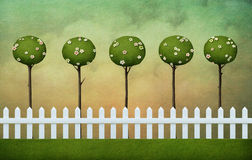 Background of fence, lawn and clouds Royalty Free Stock Photos