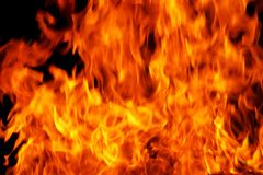 A background filled with defocused fire flames. stock photo