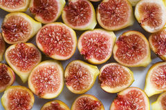 Background filled with fresh figs. Background filled with fresh sliced figs. Close-up Royalty Free Stock Photography