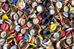 A background of beer bottle caps stock photo