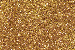 Background filled with shiny gold glitter. High res macro photo Royalty Free Stock Photography