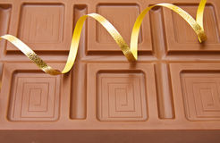 Background of fine Belgian chocolate. With festive ribbons for the celebration of a special day Stock Image