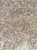 Background of fine coastal pebbles pressed tightly brown shades stock photo